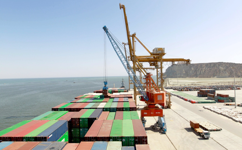 A container is loaded onto a ship in Gwadar port. (Reuters)