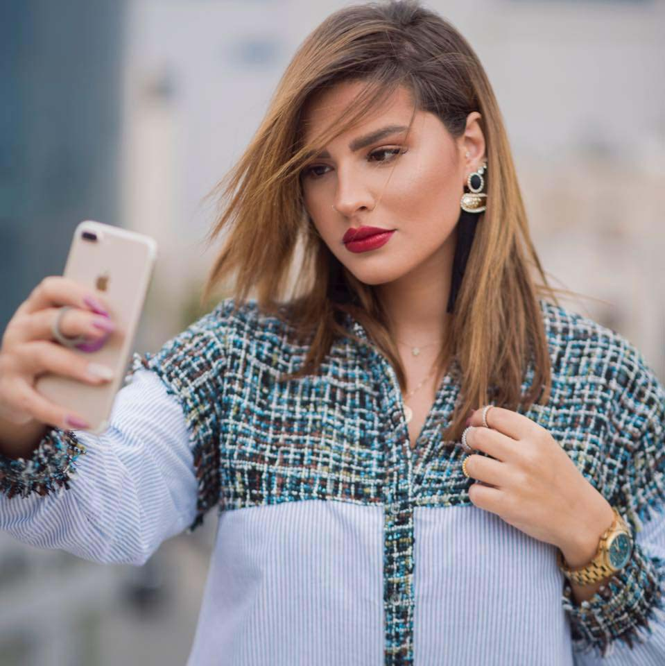Changing the rules. Jordanian influencer Anood Barqawi poses while taking a selfie.               (Facebook)