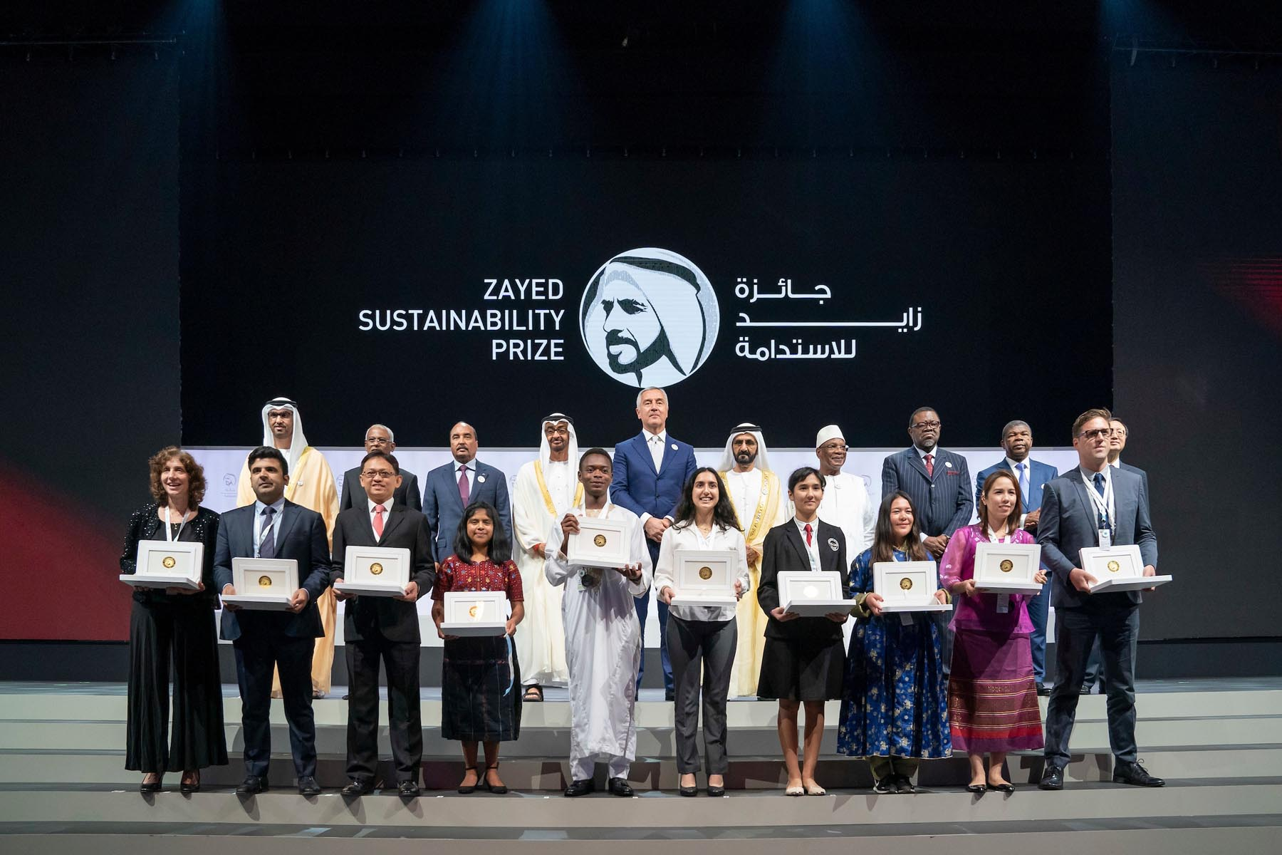 Abu Dhabi Crown Prince Sheikh Mohammed bin Zayed al-Nahyan  (2nd row, 4th L) and UAE Vice-President Sheikh Mohamed bin Rashid Al Maktoum (2nd row, 6th L) pose with the winners of the Zayed Sustainability Prize for Energy. ( Mohamed Al Hammadi)