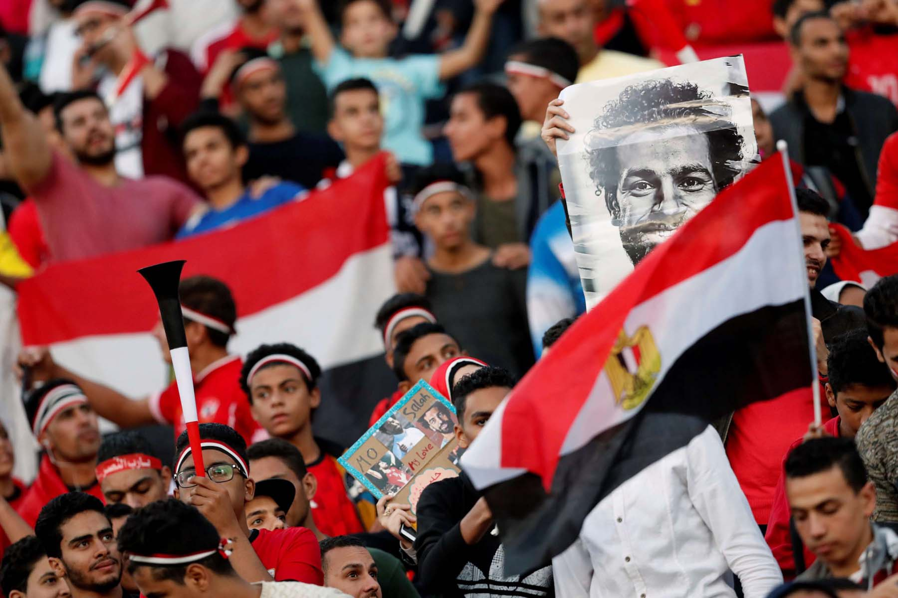 Egyptian football fans with a picture of star player Mohamed Salah before an Africa Cup of Nations Cup qualifying match in Alexandria, last November. (Reuters)