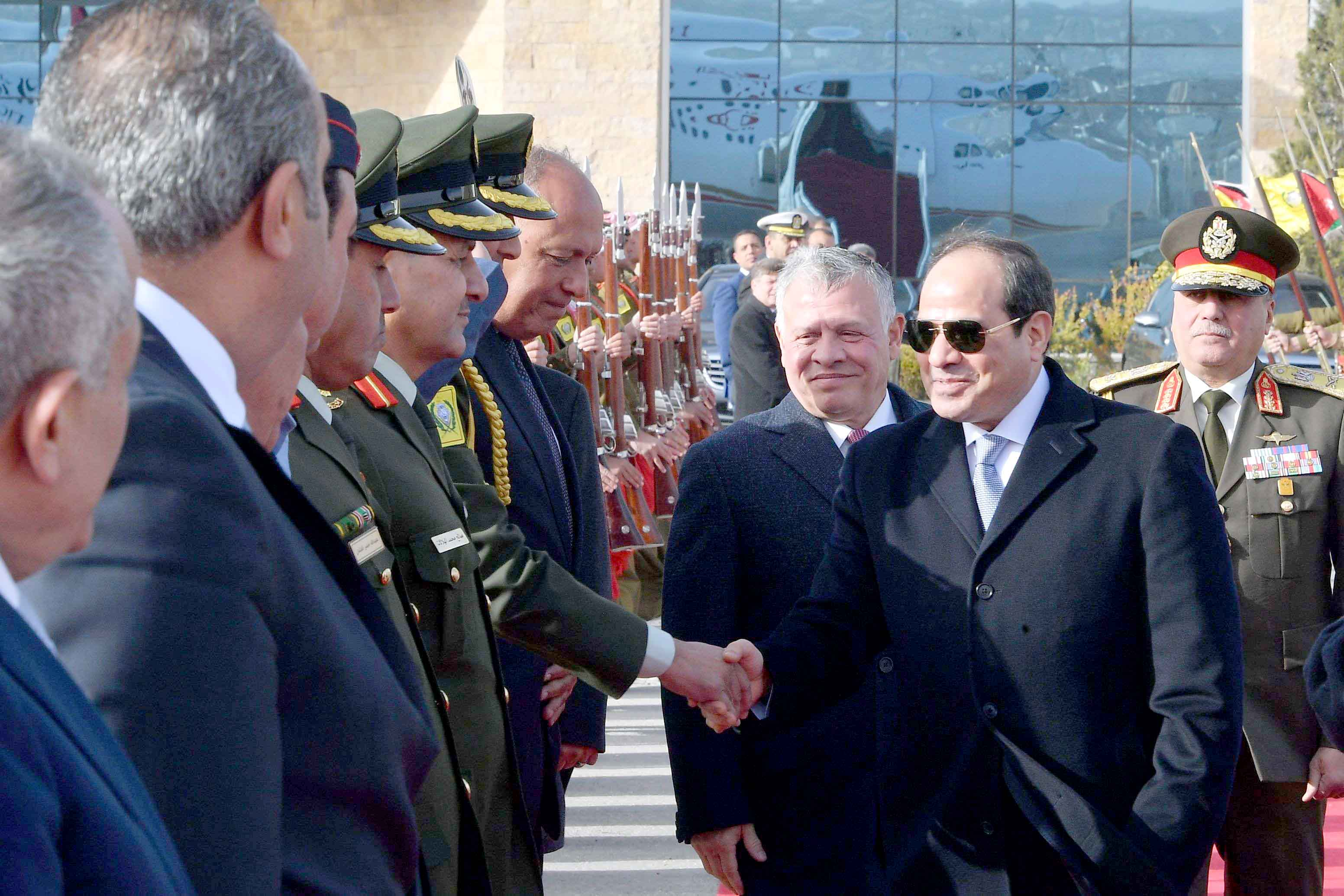 Searching for peace and security. Egyptian President Abdel Fattah al-Sisi (2nd-R) and Jordanian King Abdullah II (3rd-R) at a welcoming ceremony in Amman, January 13.(AFP)