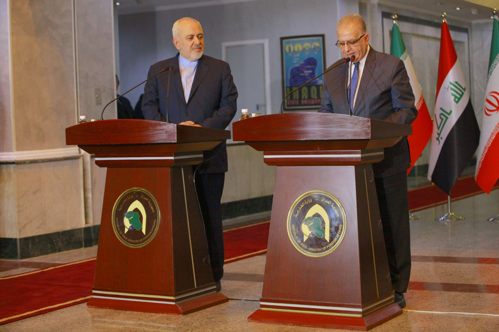 Iraqi Foreign Minister Mohammad Ali al-Hakim (R) speaks during a news conference with his Iranian counterpart Mohammad Javad Zarif (L) after their meeting in Baghdad,  January 13. (DPA)