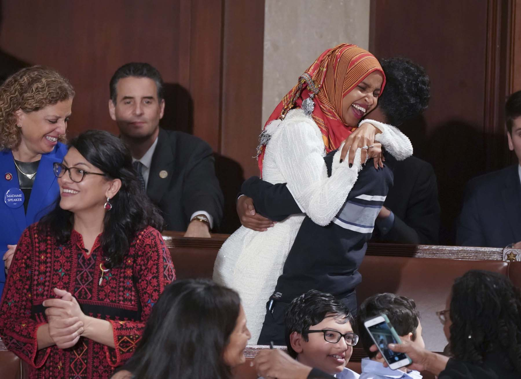 American tale. Congresswomen Rashida Tlaib of Michigan (L) and Ilhan Omar of Minnesota (R) after their swearing-in at the US House of Representatives, January 4.      (AP)