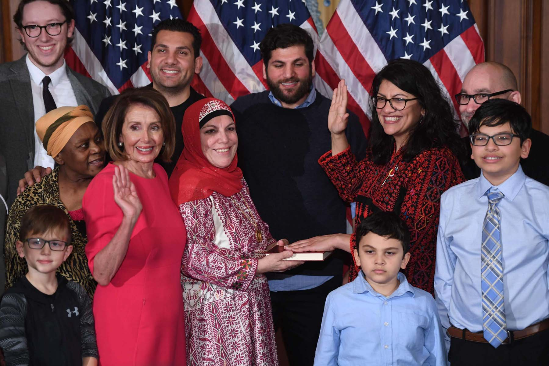 US House Representative member Rashida Tlaib (3rd R) participates in a ceremonial swearing-in with Speaker of the House Nancy Pelosi (4th R) , January 4. (AFP)