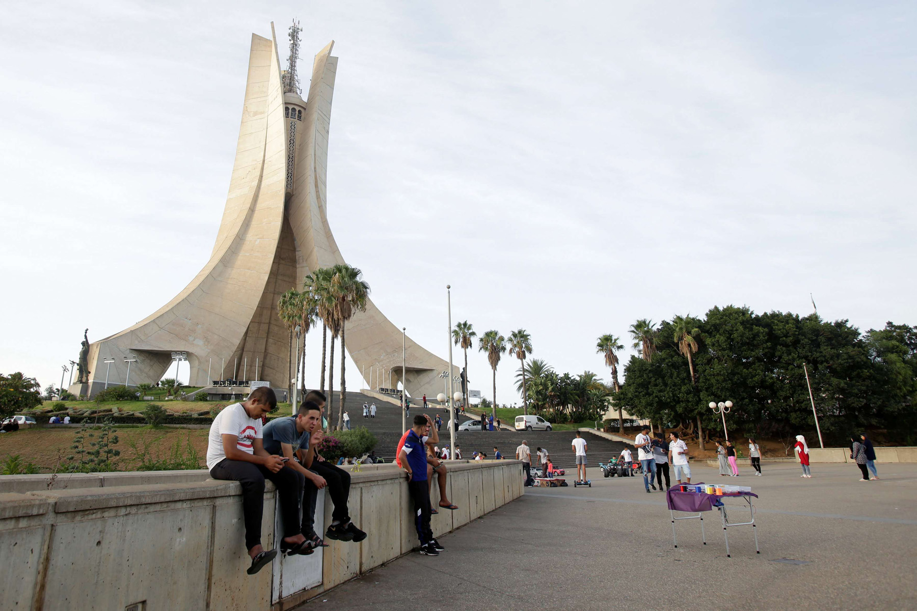 Youths sit near the Martyrs' Memorial in Algiers, Algeria September 10, 2018. (Reuters)
