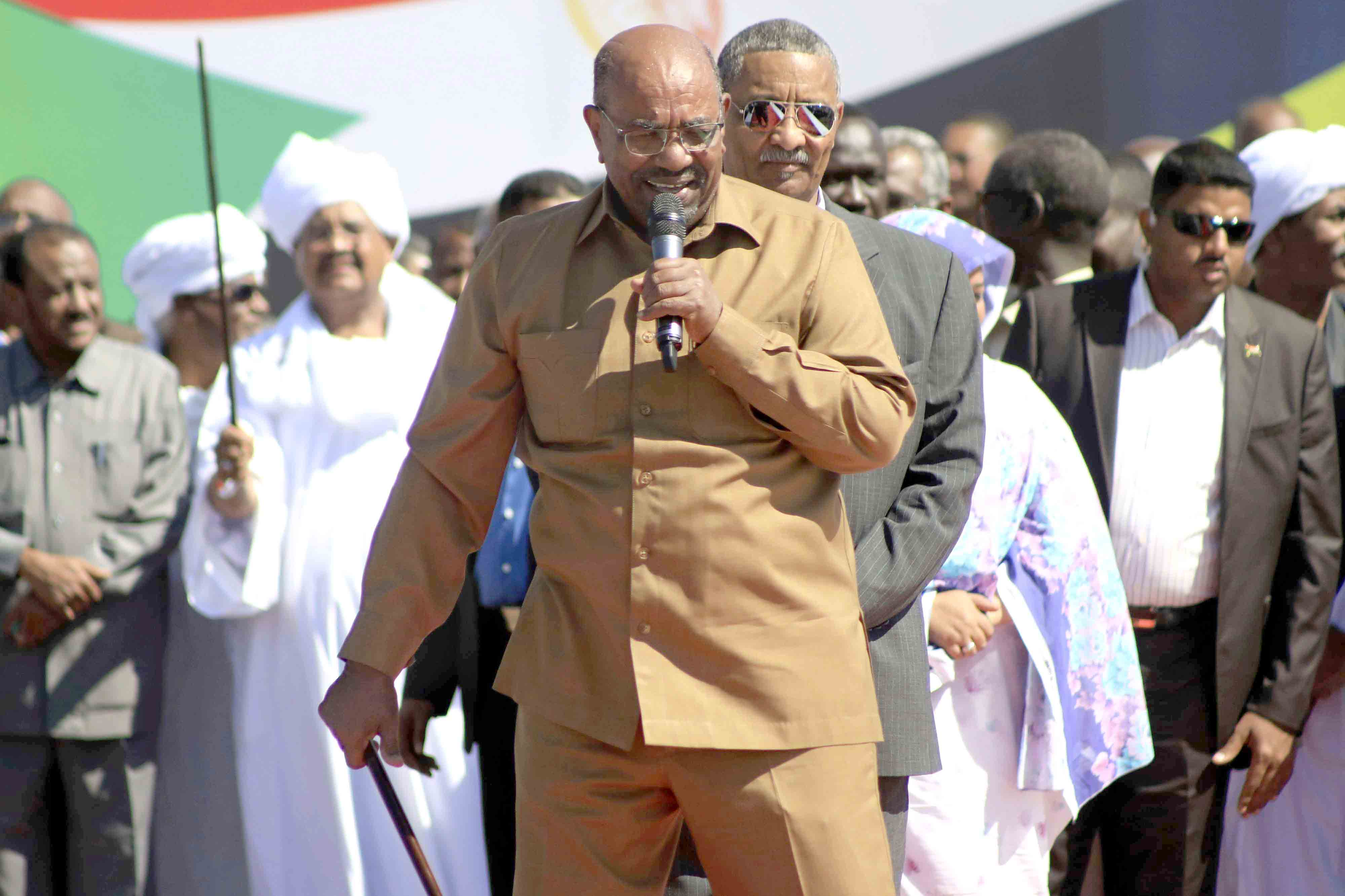 Unbowed. Sudan's President Omar al-Bashir addresses supporters at a rally in Khartoum, January 9. (AP)