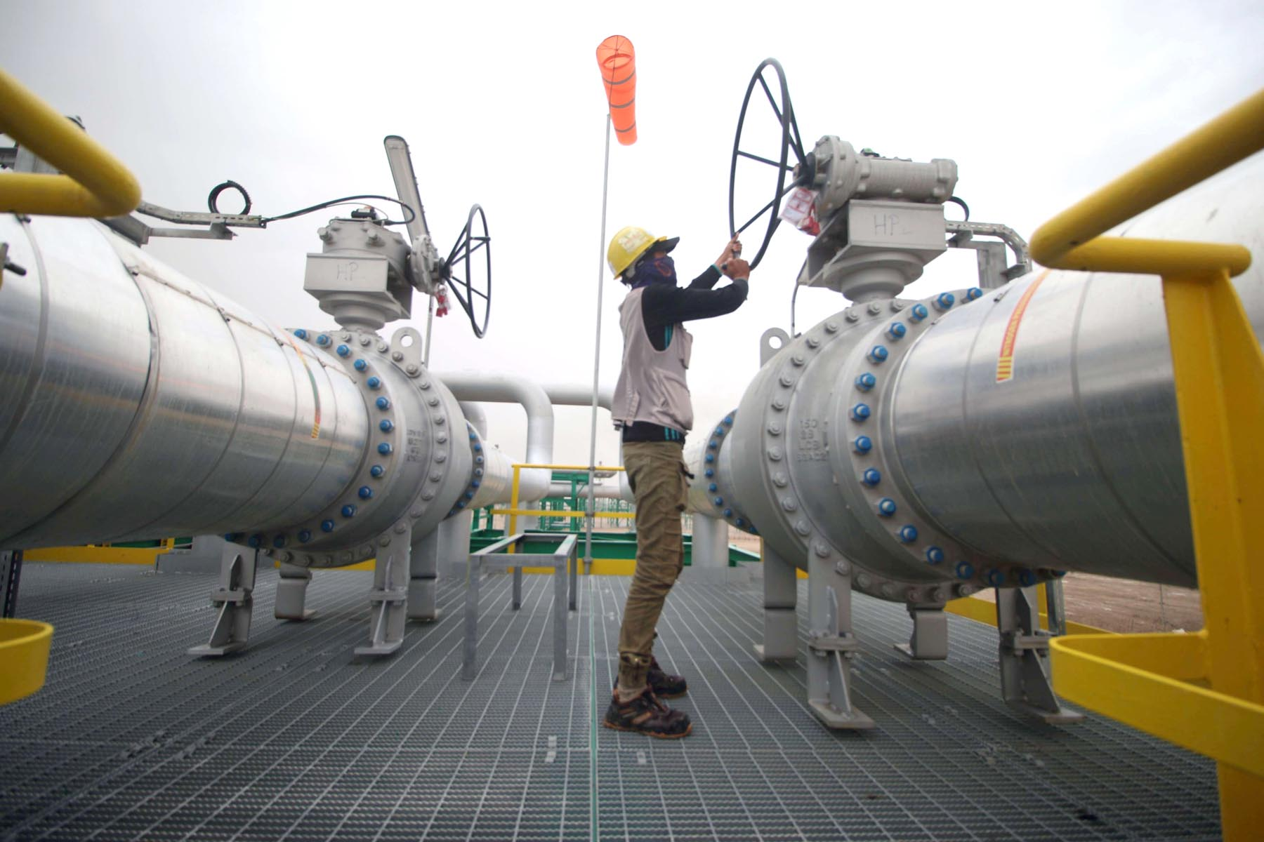 An employee turns a valve at the Hammar Mushrif station inside the Zubair oil and gas field, north of Basra.      (AFP)