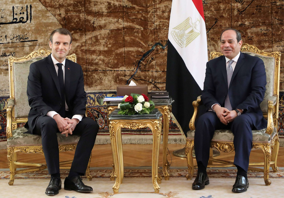 Strategic interests. French President Emmanuel Macron (L) meets with his Egyptian counterpart Abdel Fattah al-Sisi at the presidential palace in Cairo, January 28. (AFP)