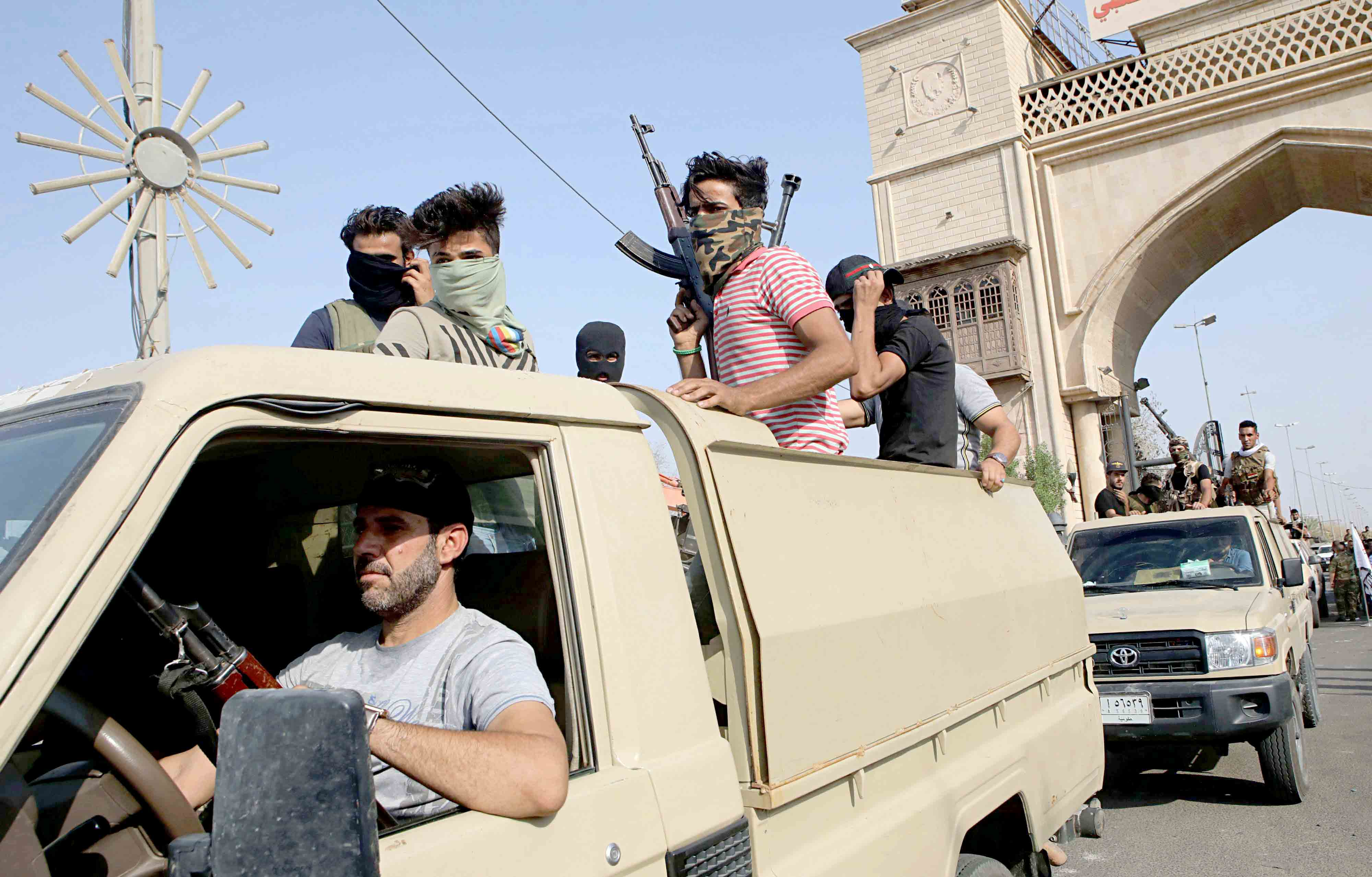 Fighters from the Popular Mobilisation Forces parade in Basra, last September. (AP)