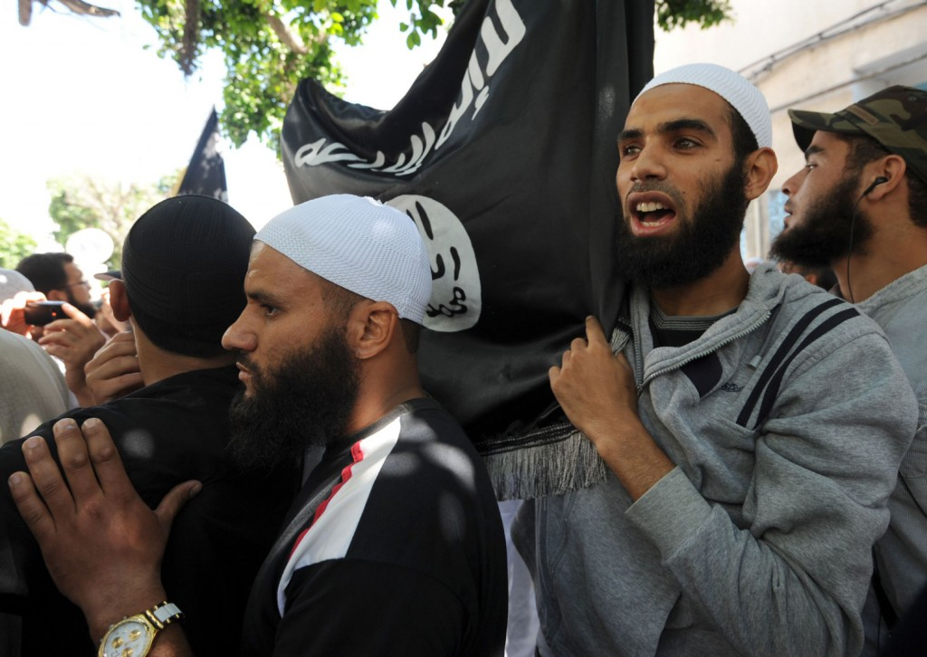A file picture shows Tunisian Salafists shouting slogans as they gather in front of a courthouse in Tunis. (AFP)