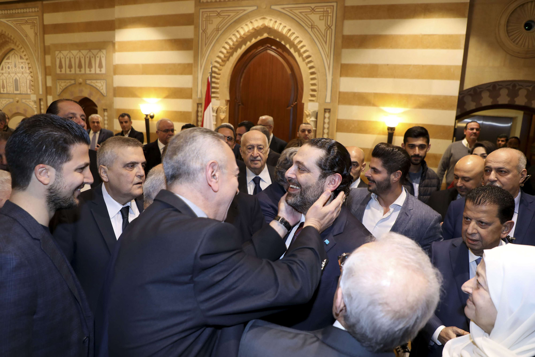Lebanese Prime Minister Saad Hariri (C) stands among supporters after a news conference during which he announced the formation of a new government, January 31. (DPA)