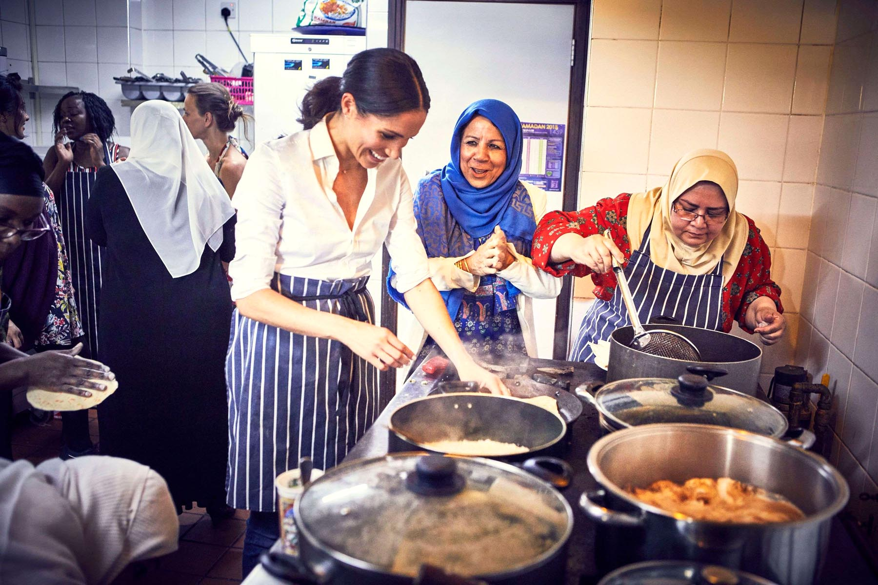 Meghan Markle, Duchess of Sussex, cooks with Muslim women at the Al Manaar Muslim Cultural Heritage Centre in West London, last September. (Kensington Palace)