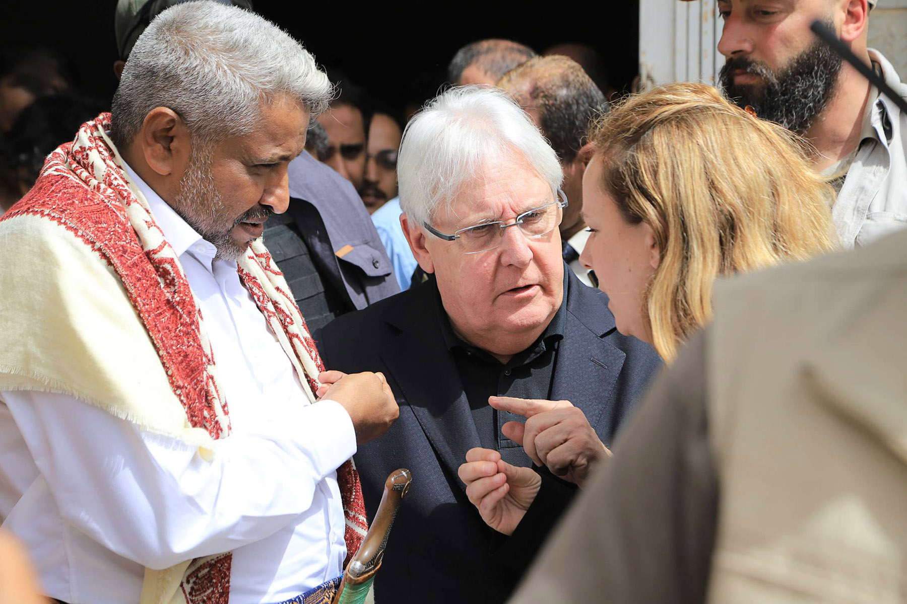 Daunting task. UN Special Envoy for Yemen Martin Griffiths (C) listens to an assistant as he stands with the Houthi-appointed governor of Hodeidah Muhammad Aiyyash Quhaim, January 29.      (Reuters)