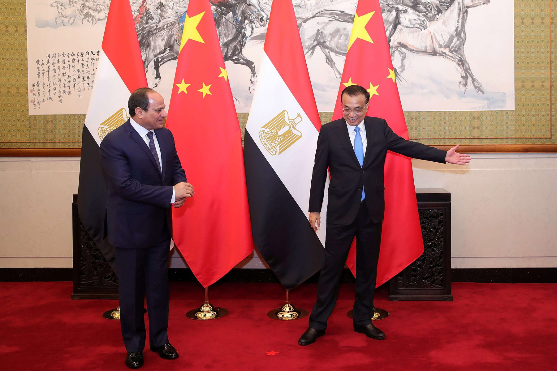 Showing the way. Egypt's President Abdel Fattah al-Sisi (L) and Chinese Premier Li Keqiang at Diaoyutai State Guesthouse in Beijing, last September. (Reuters)