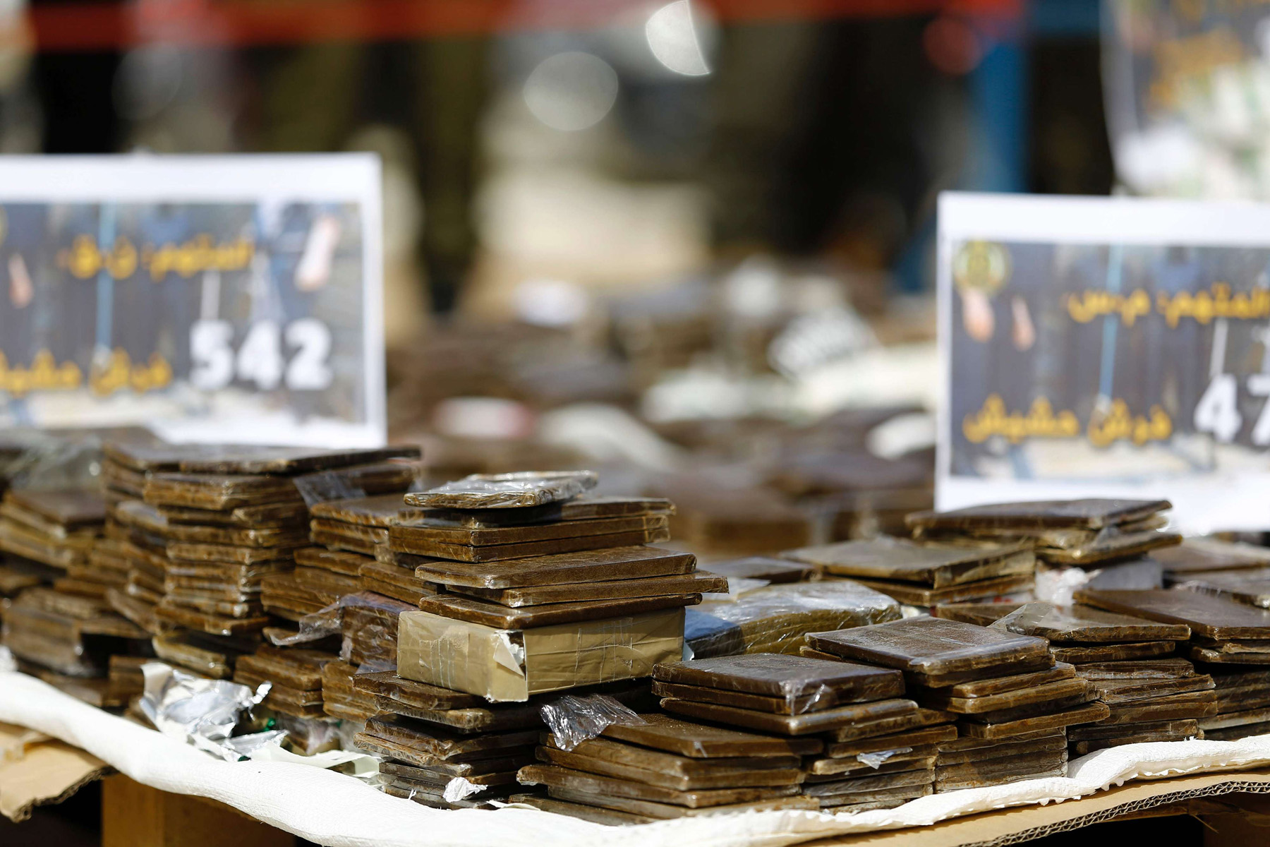 More than one route. A pile of confiscated bars of hashish on display before being burnt in Gaza City.  (AFP)