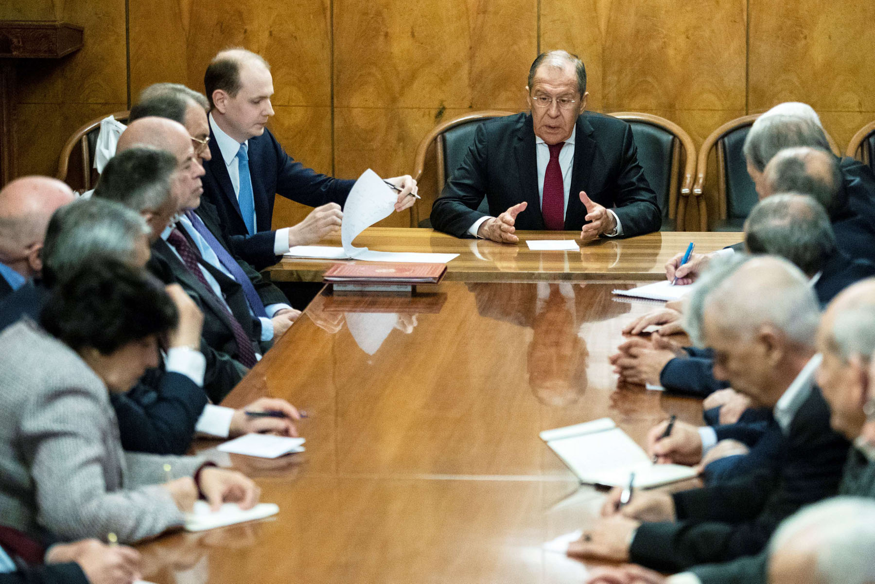 Exploiting the vacuum. Russian Foreign Minister Sergei Lavrov (C) talks during a meeting with representatives of Palestinian groups and movements in Moscow, February 12.   (Reuters)