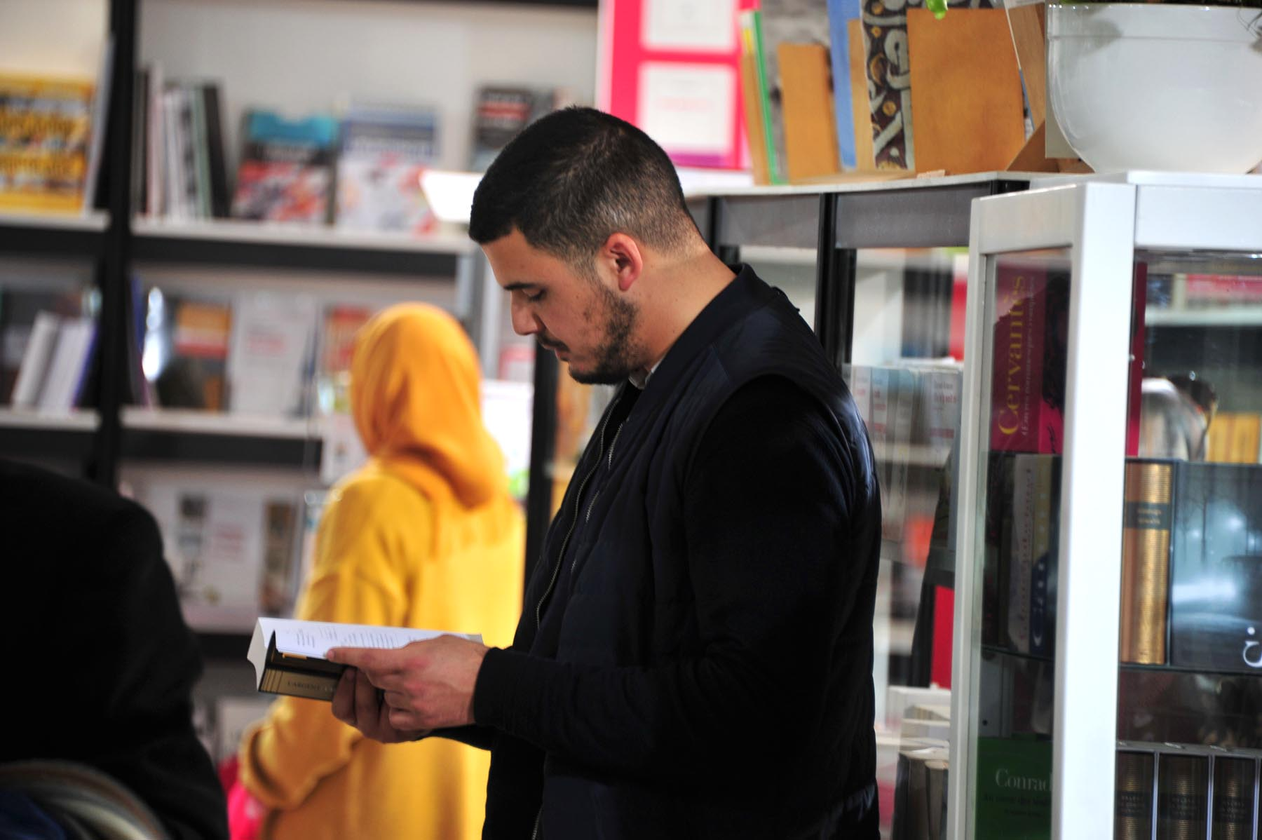 Still striving for quality. A visitor browses through a book at the 25th edition of Casablanca's International Book Fair.     (Saad Guerraoui)