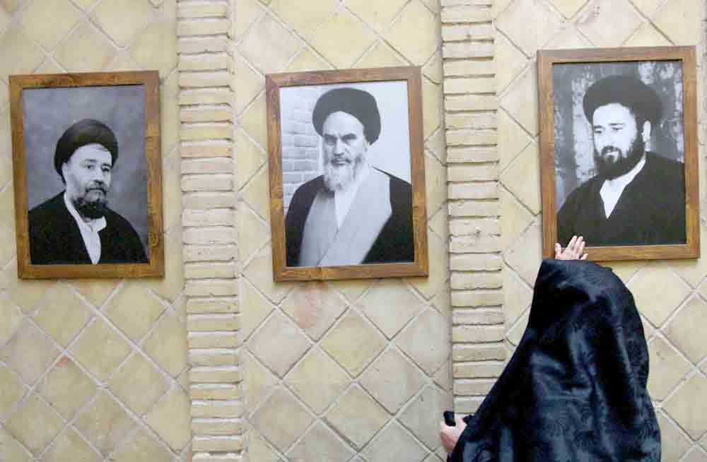 A picture of the late Iranian revolutionary leader Ayatollah Ruhollah Khomeini (C) is seen at his former home in Najaf, Iraq, February 9. (Reuters)