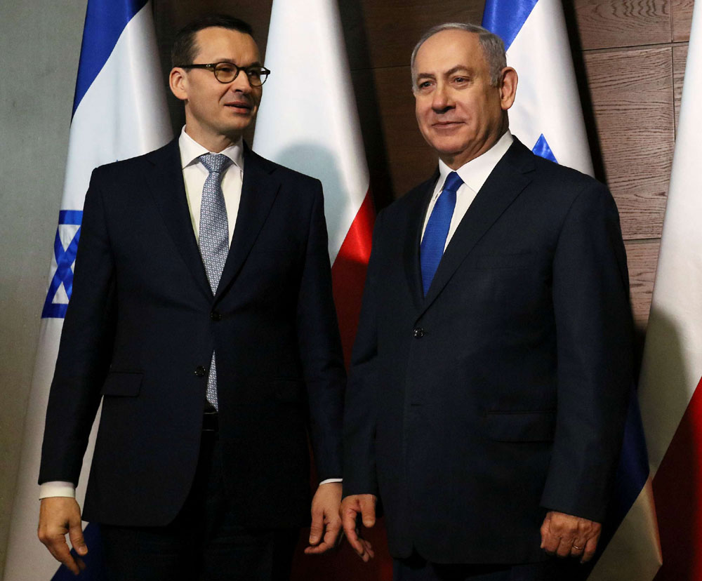 Israeli Prime Minister Binyamin Netanyahu (R) poses with Polish Prime Minister Mateusz Morawiecki during the Middle East summit in Warsaw, February 14. (Reuters)