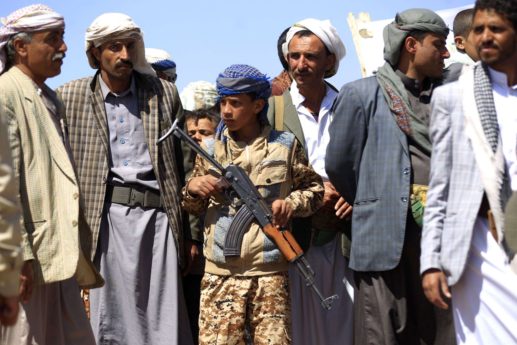 A young Yemeni holds a rifle as he takes part in a gathering near Sana'a to show support for Houthis. (AP)