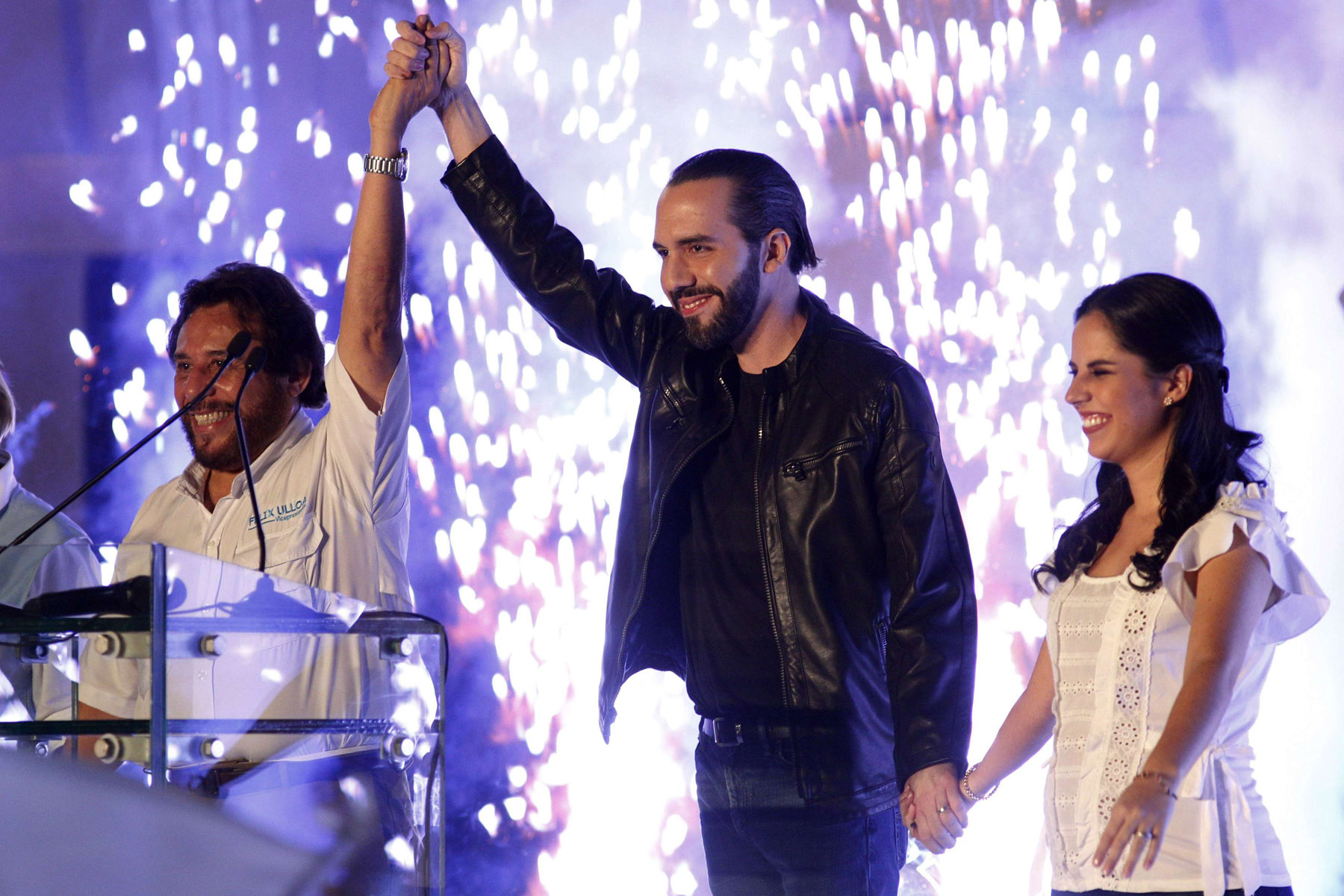 Smart popularity. Bukele, of the Grand Alliance for National Unity (C) his wife Gabriela, (R) and the Vice-president candidate Felix Ulloa wave supporters in San Salvador, El Salvador, February 3. (AP)