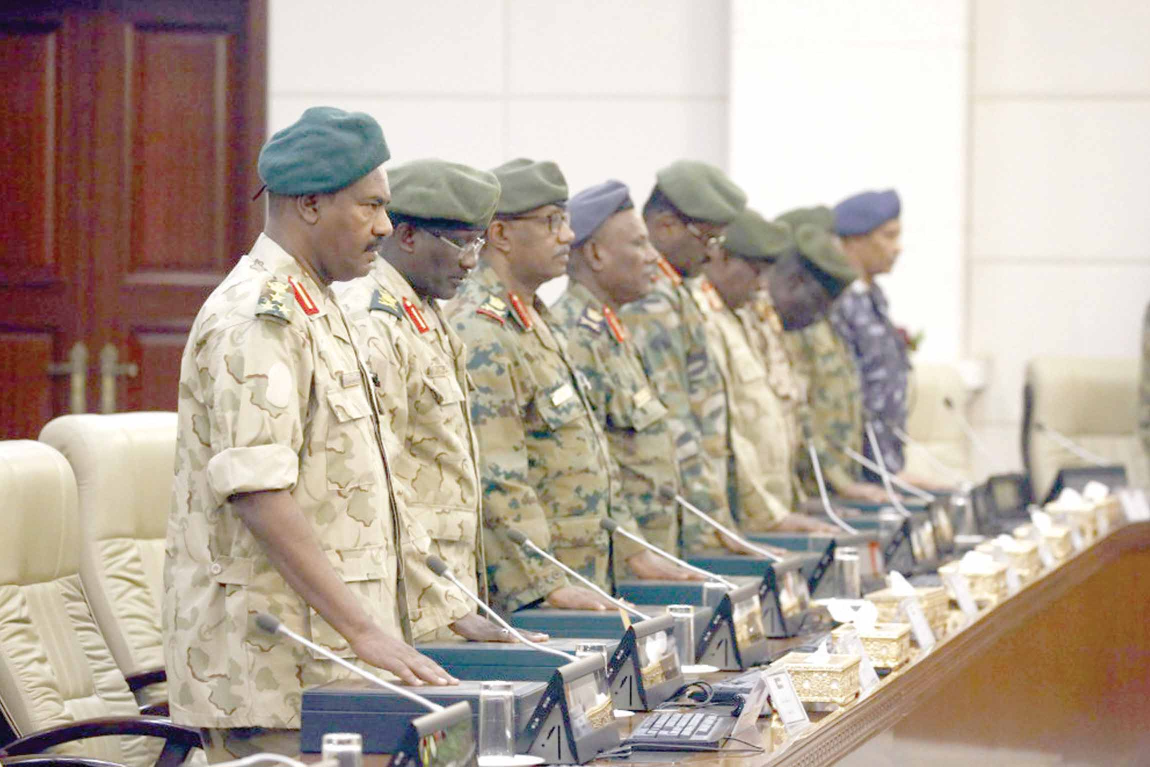 Former Sudanese Army officers are sworn in as governors in Khartoum,  February 24. (AFP)