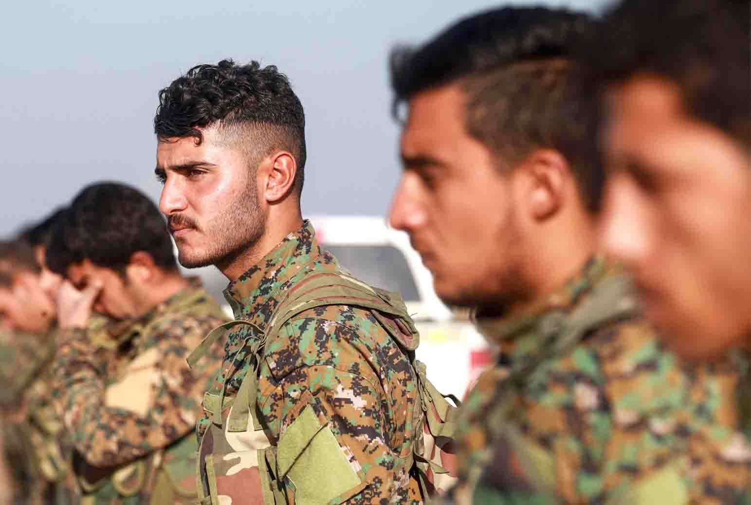 Fighters from the Syrian Democratic Forces (SDF) in the town of Tell Tamr in the countryside of Syria's  north-eastern Hasakah province, last December. (AFP)