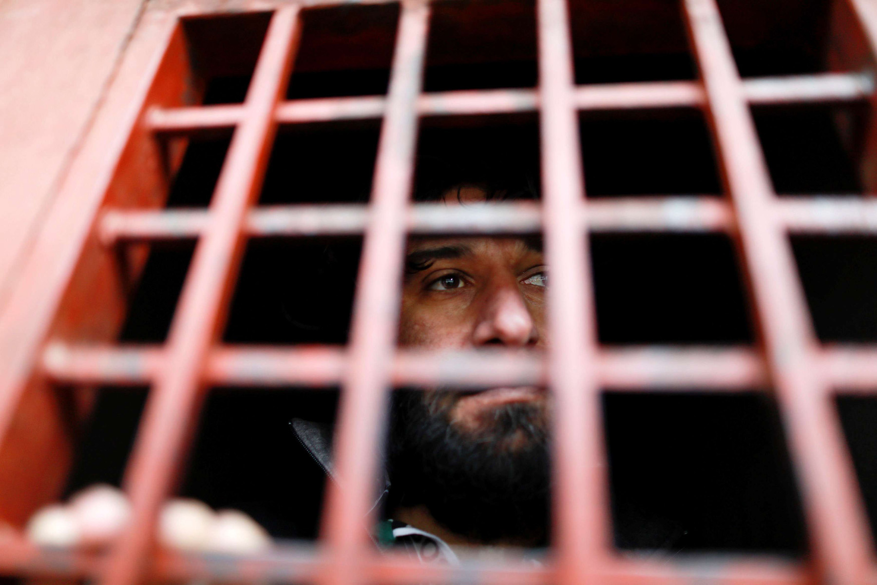 An ISIS member looks out from a prison cell in Sulaymaniyah, Iraq.  (Reuters)