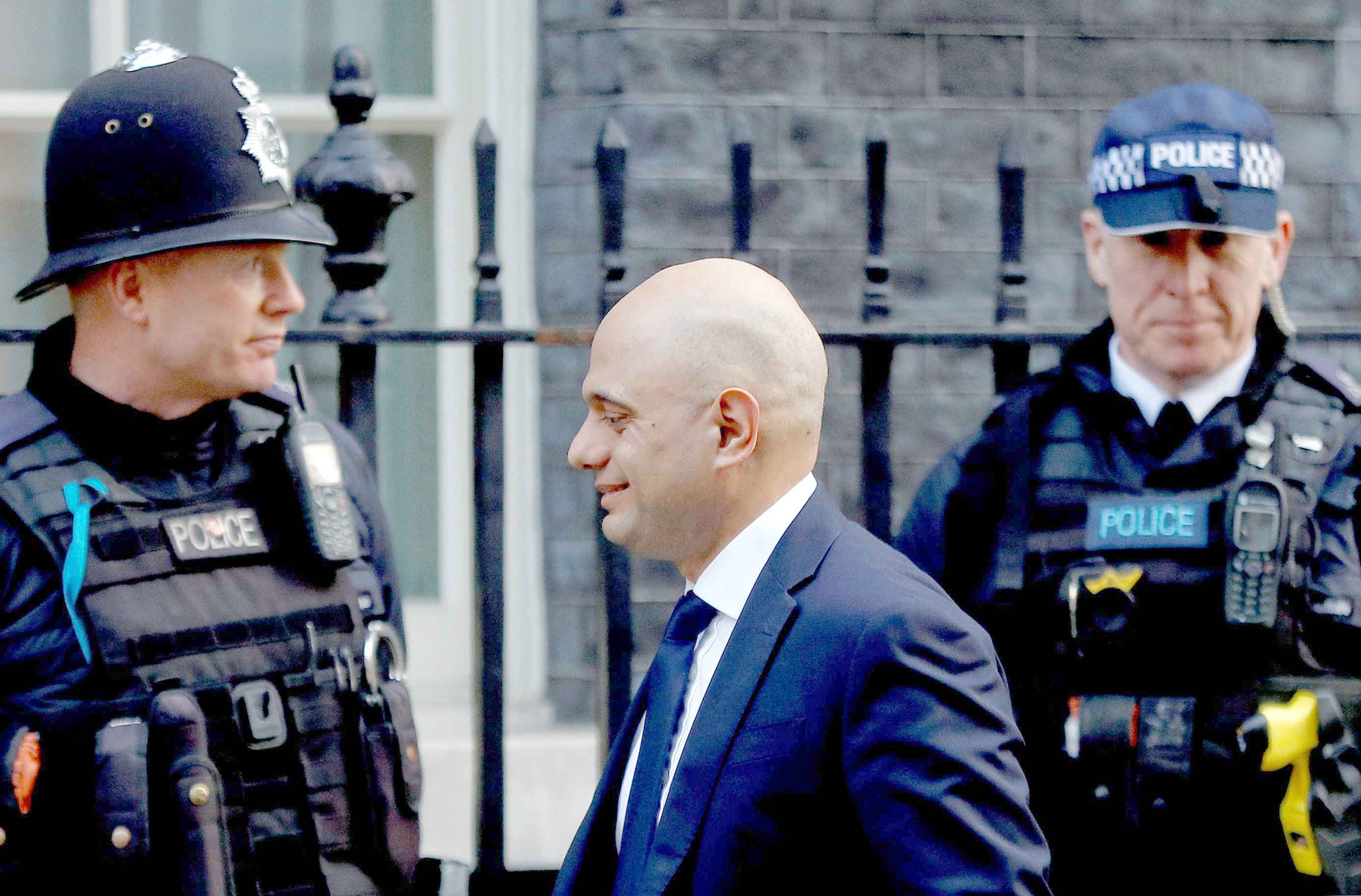 Long-overdue. Britain's Home Secretary Sajid Javid (C) outside of Downing Street in London,  February 19.(Reuters)
