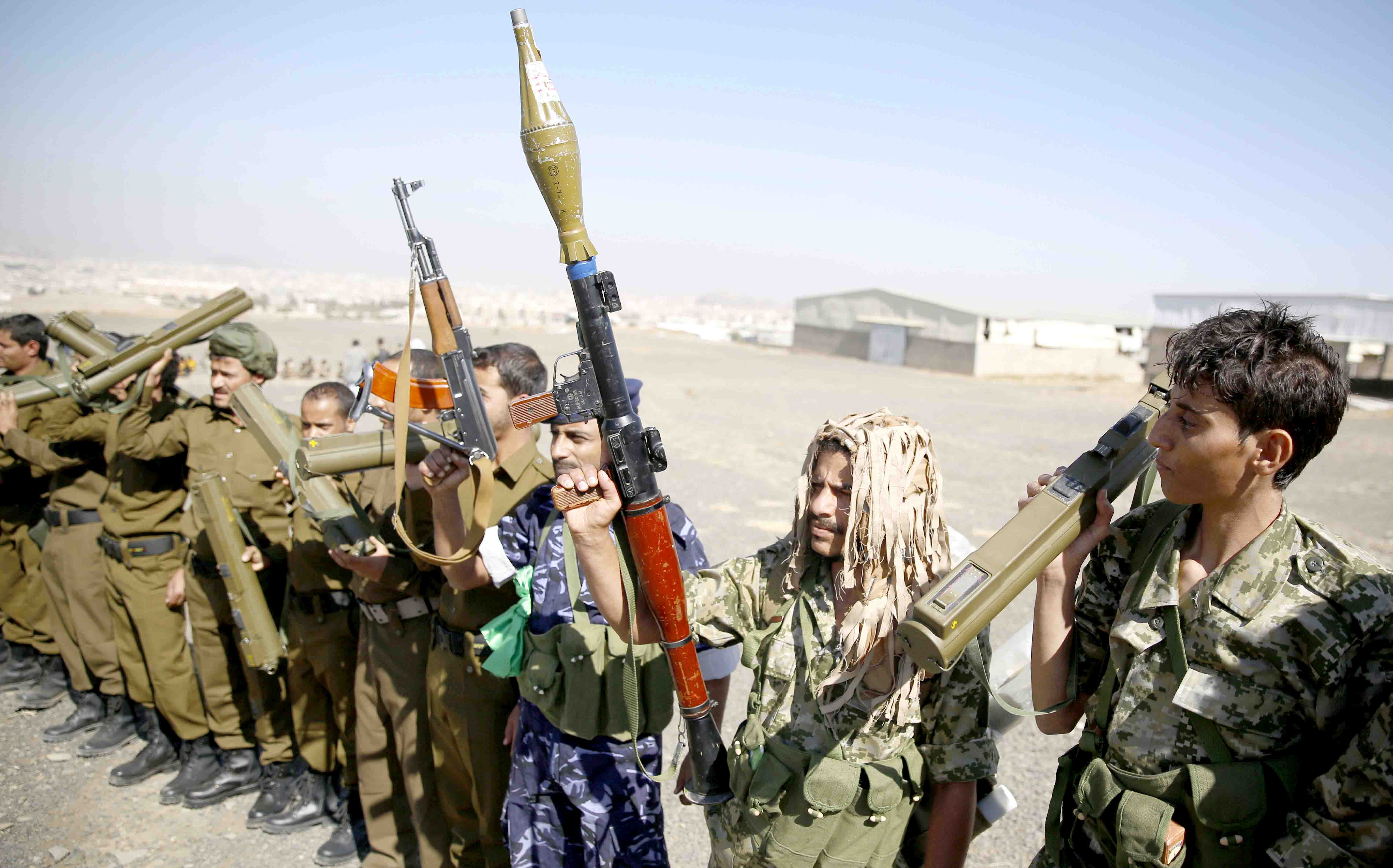 Houthi fighters hold their weapons during a tribal gathering in Sana'a. (AP)