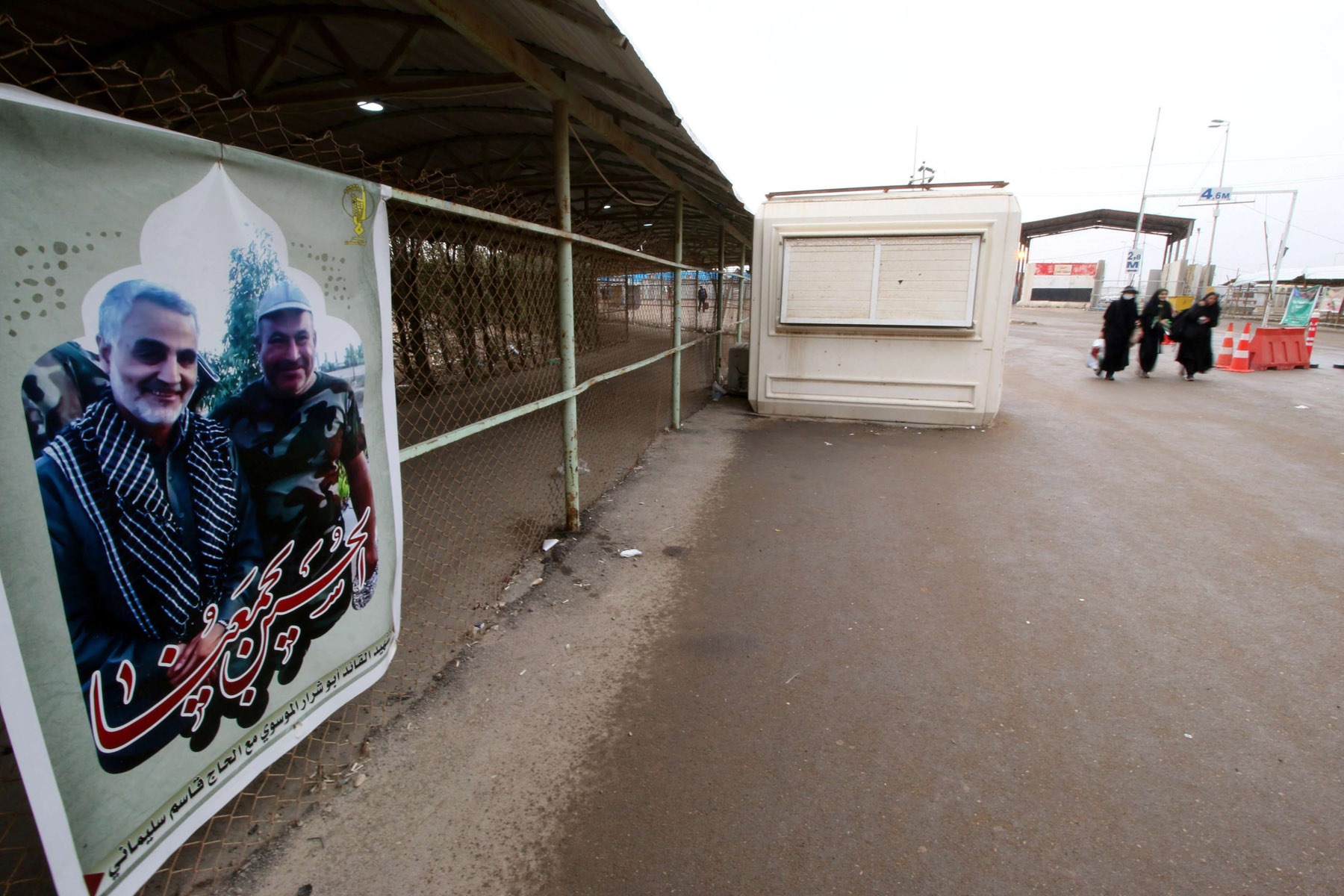 A poster of a member of the Popular Mobilisation Forces (PMF) and Iranian Major-General Qassem Soleimani at Iraqi side of the Shalamcha Border Crossing in Iraq. (Reuters)