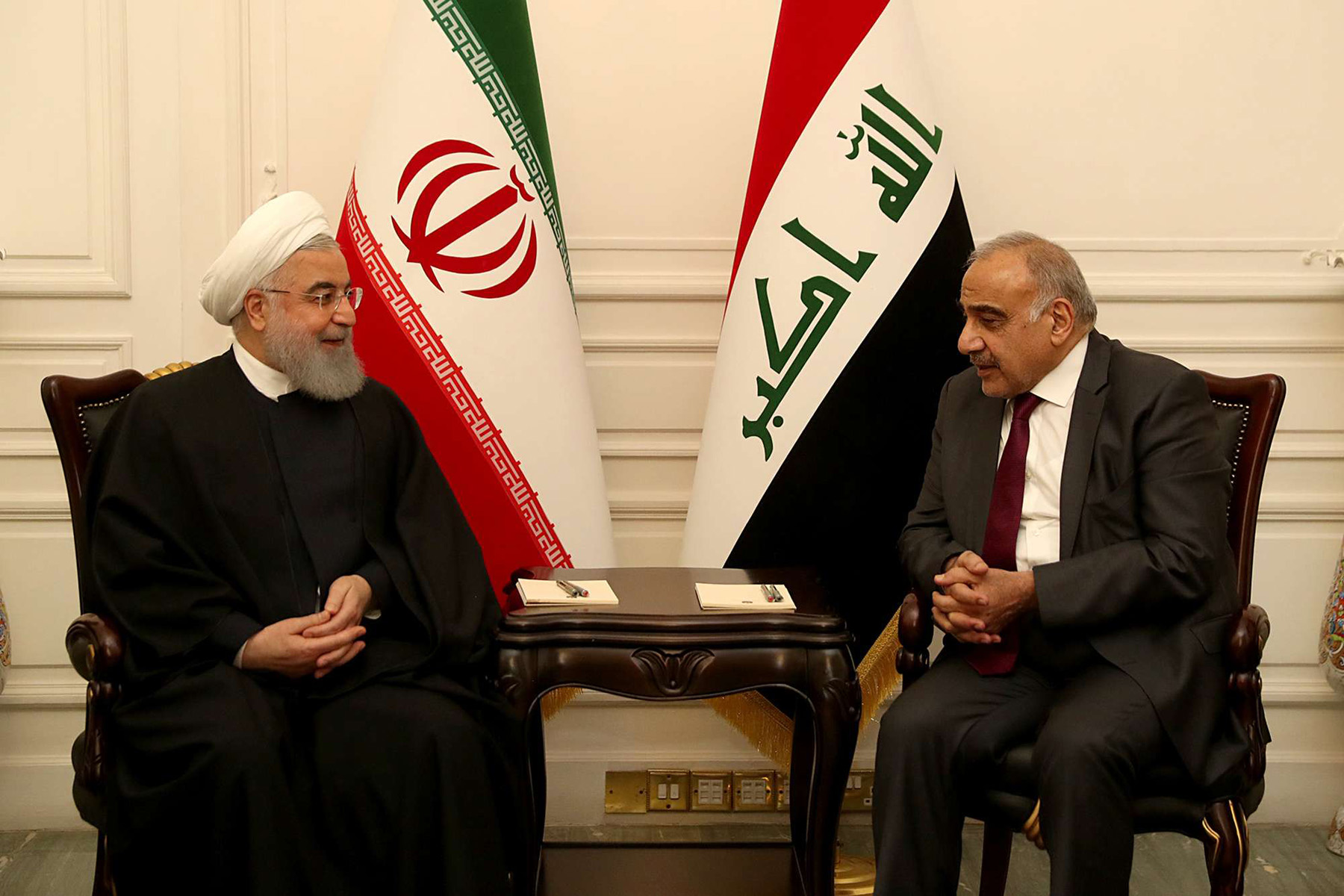 Encroachment ambitions. Iraqi Prime Minister Adel Abdul-Mahdi (R) meets with Iranian President Hassan Rohani in Baghdad, March 11.  (Reuters)