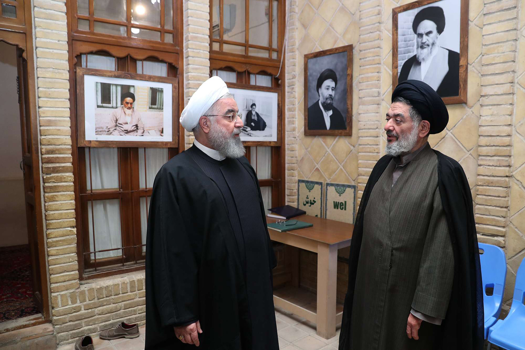 Iranian President Hassan Rouhani (L) visits the historical-cultural complex, in which Former Supreme Leader of Iran Ruhollah Khomeini spent his exile time, March 13, 2019. (DPA)