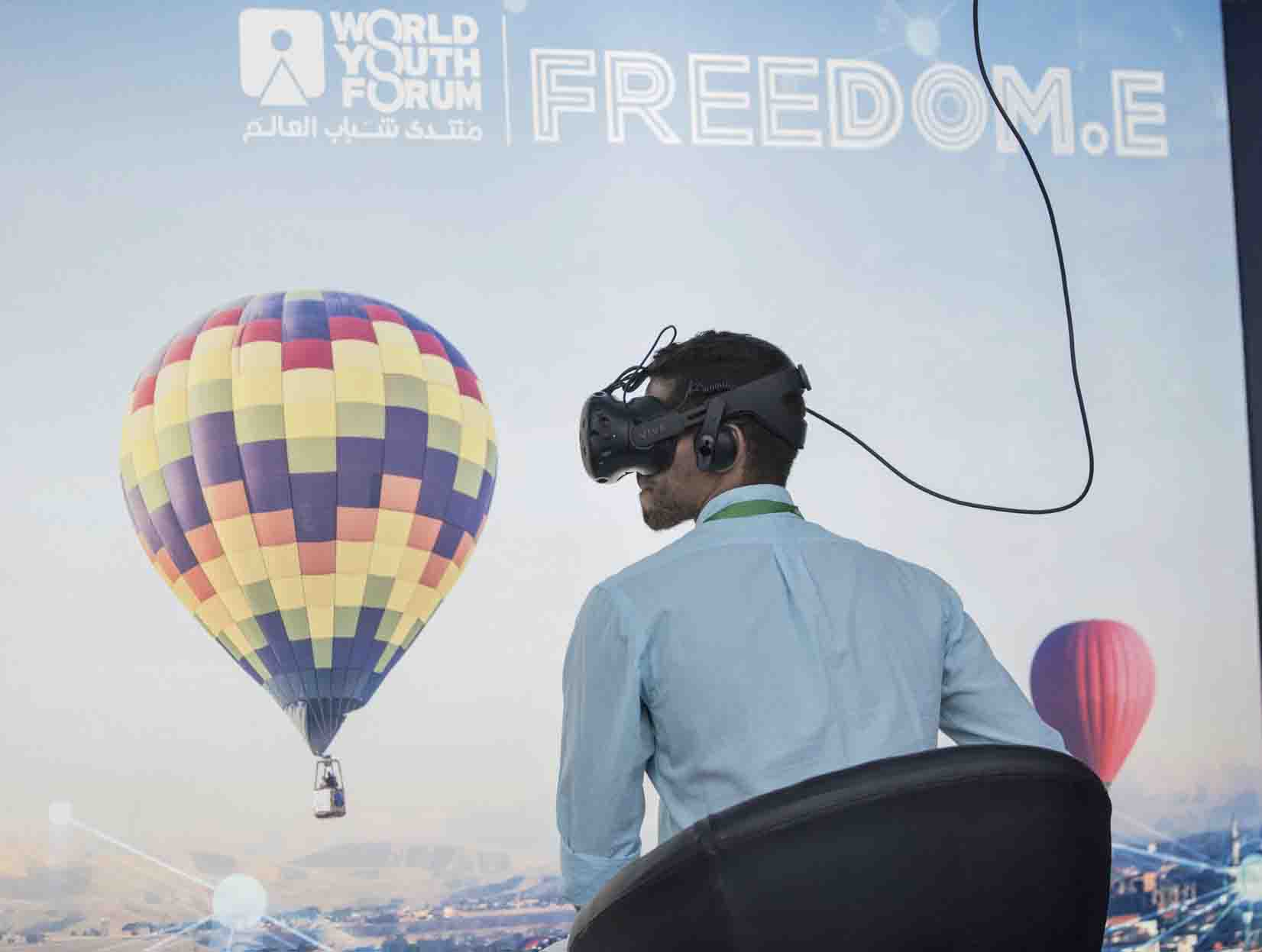 A young man uses a VR headset on the second day of the World Youth Forum in Sharm  el-Sheikh, last November. (AP)