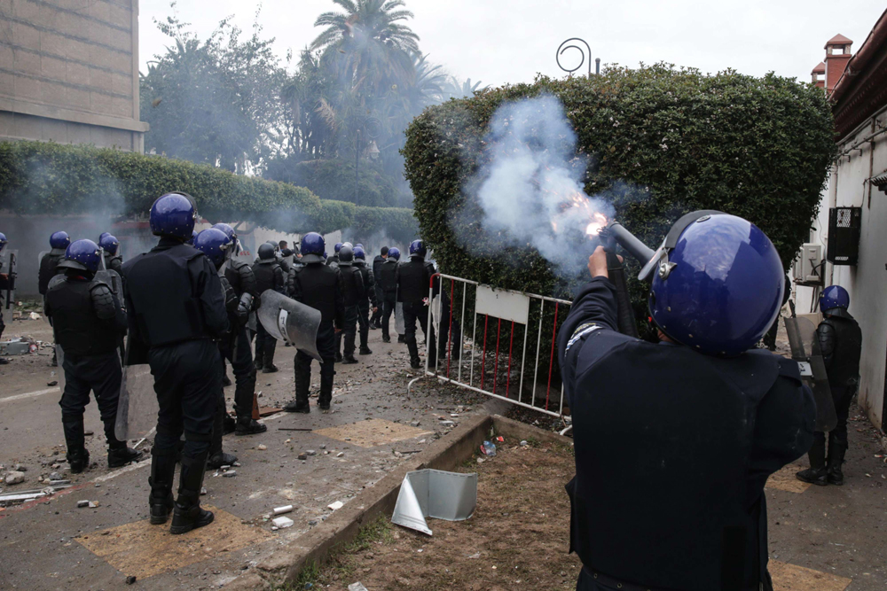 Algerian riot police clashes with protestors (not pictured) demonstrating in Algiers against Algerian President Abdelaziz Bouteflika, on March 8. (DPA)