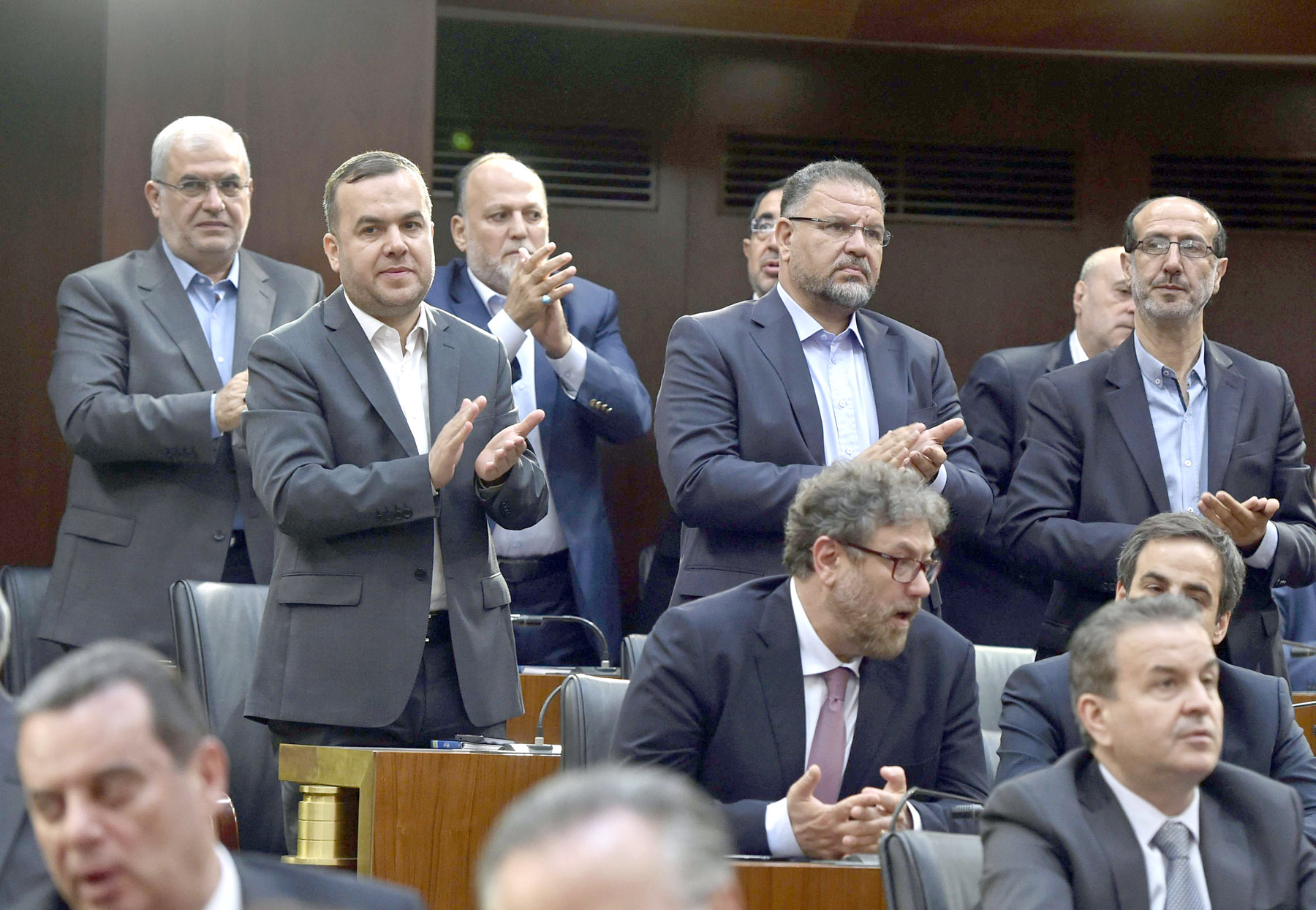 Calling the shots. Members of Hezbollah's parliamentary bloc applaud during a session at the parliament building in Beirut.  (AP)