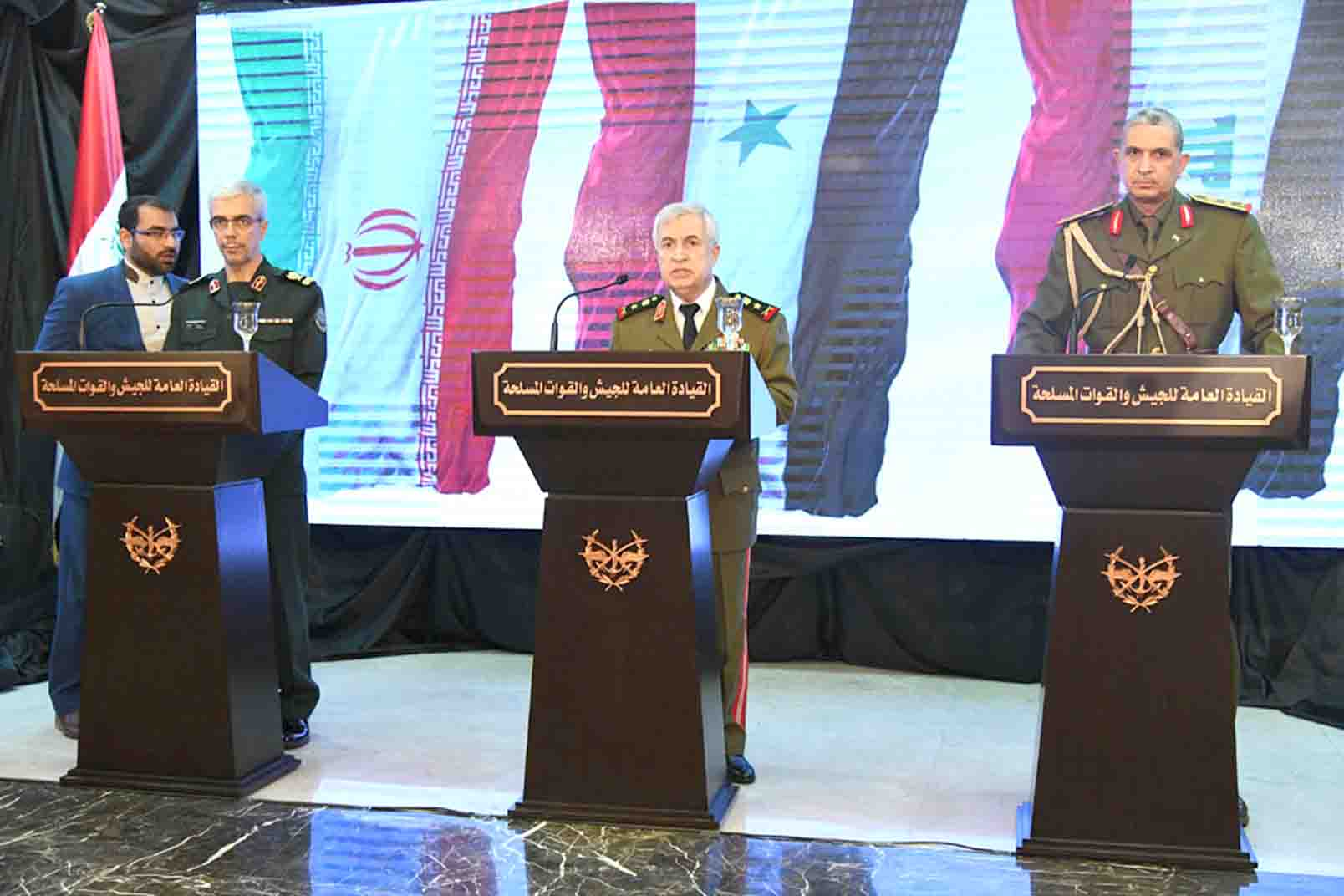 Syrian Defence Minister Ali Abdullah Ayyoub (C), Iraq's Chief of Staff Othman al-Ghanimi (R) and Iranian Chief of Staff Mohammad Hossein Bagheri (2nd L) at a news conference in Damascus, March 18. (dpa)