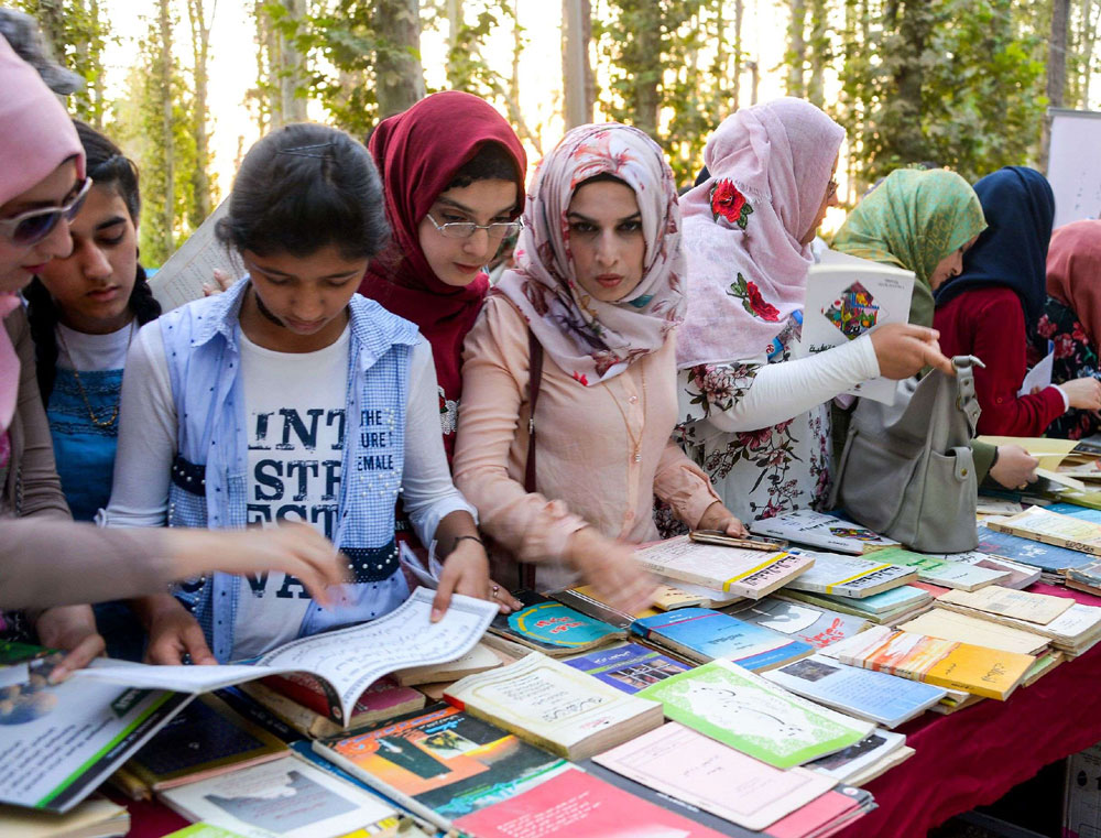 Young Iraqi women browse titles on display at a book festival in the northern city of Mosul, last September. (AFP)
