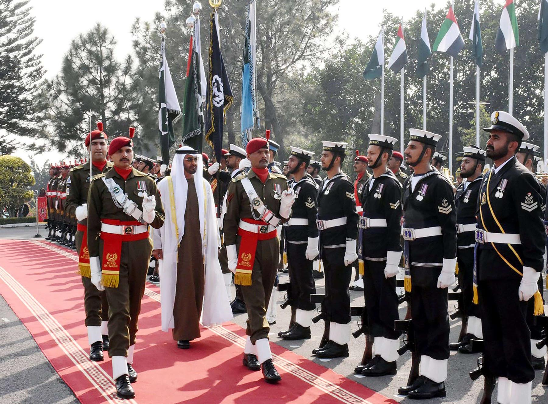 High stakes. Abu Dhabi's Crown Prince Sheikh Mohammed bin Zayed al-Nahyan (3L) reviews a guard of honour at the Prime Minister House in Islamabad, last January.    (AFP)