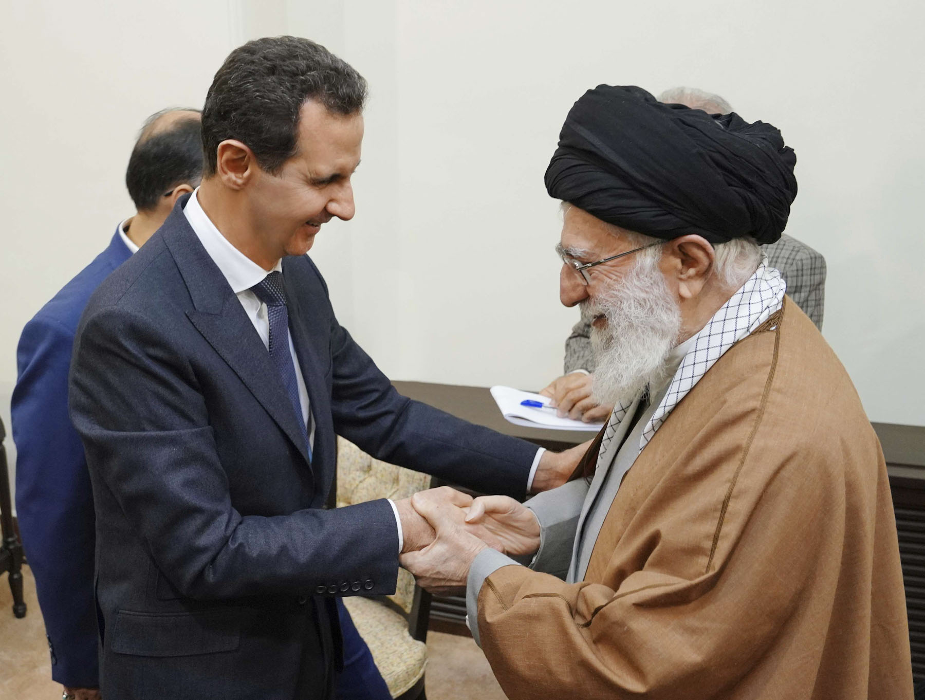 Syrian President Bashar Assad, left, shakes hands with Iranian Supreme Leader Ayatollah Ali Khamenei, before their meeting in Tehran, Syria, Monday, Feb. 25, 2019. (AP)
