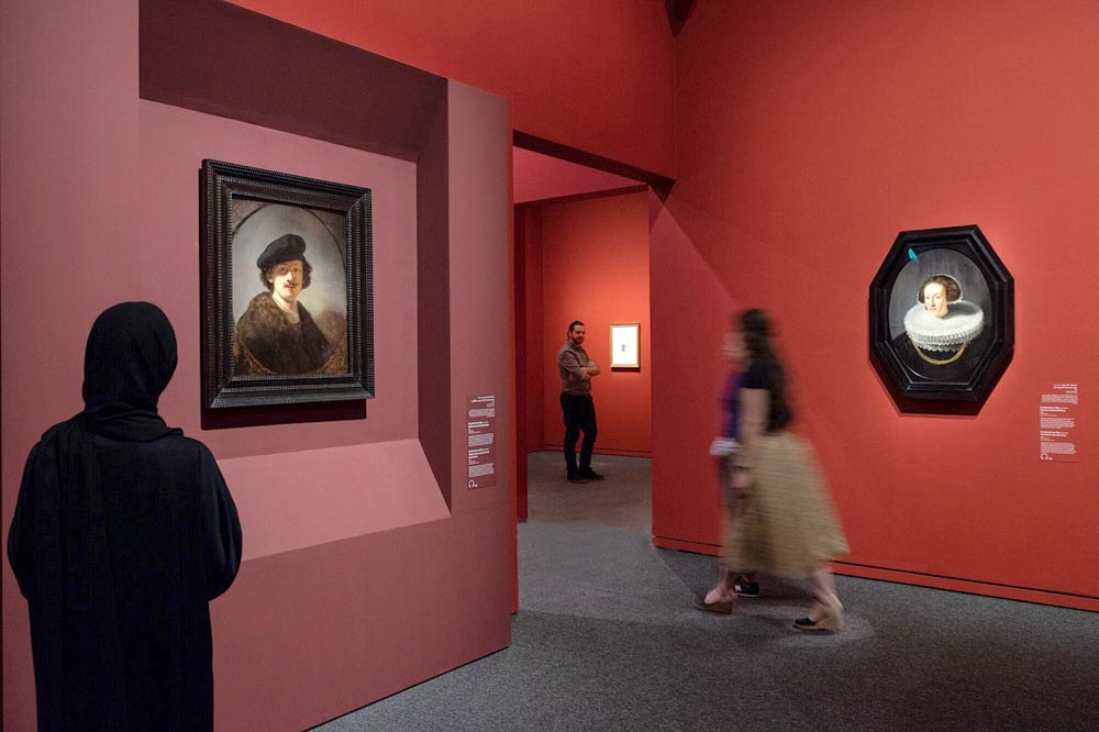 "Visitors look at works on display as part of ""Rembrandt, Vermeer and the Dutch Golden Age: Masterpieces from the Leiden Collection and the Musee du Louvre.""    (Mohamed Somji)"