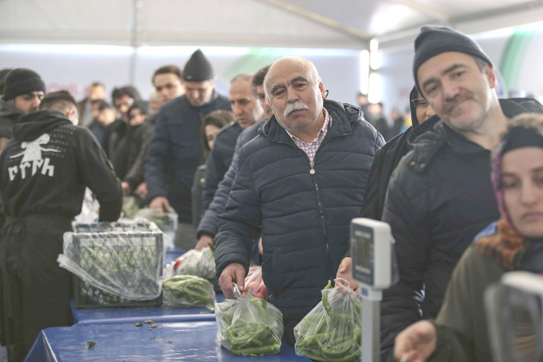 Crisis mode. Shoppers queue to buy groceries at a government-run market selling vegetables at discounted prices in an Istanbul  neighbourhood.   (AP)