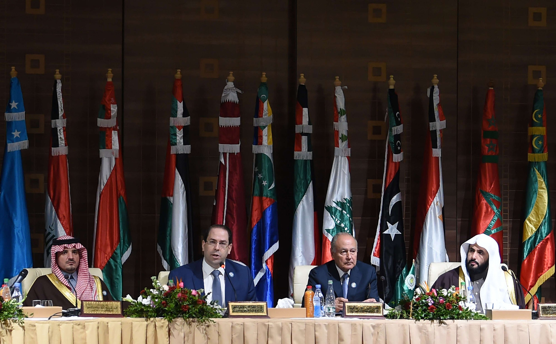 Tunisian Prime Minister Youssef Chahed (2nd-L) gives a speech during the opening session of a meeting of Arab Interior and Justice Ministers in the capital Tunis on March 4, 2019. (AFP)