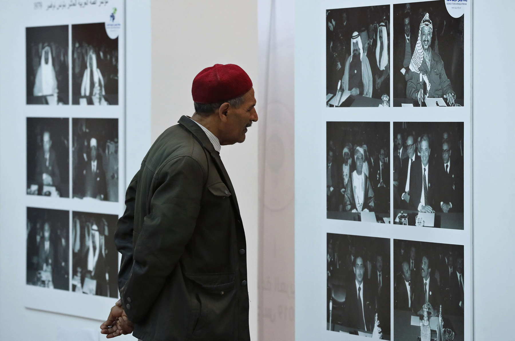 Modest expectations. A Tunisian man looks at photos of Arab leaders who attended the 1979 Arab League Summit, in the media centre, at the Culture City in Tunis, March 27. (AP)