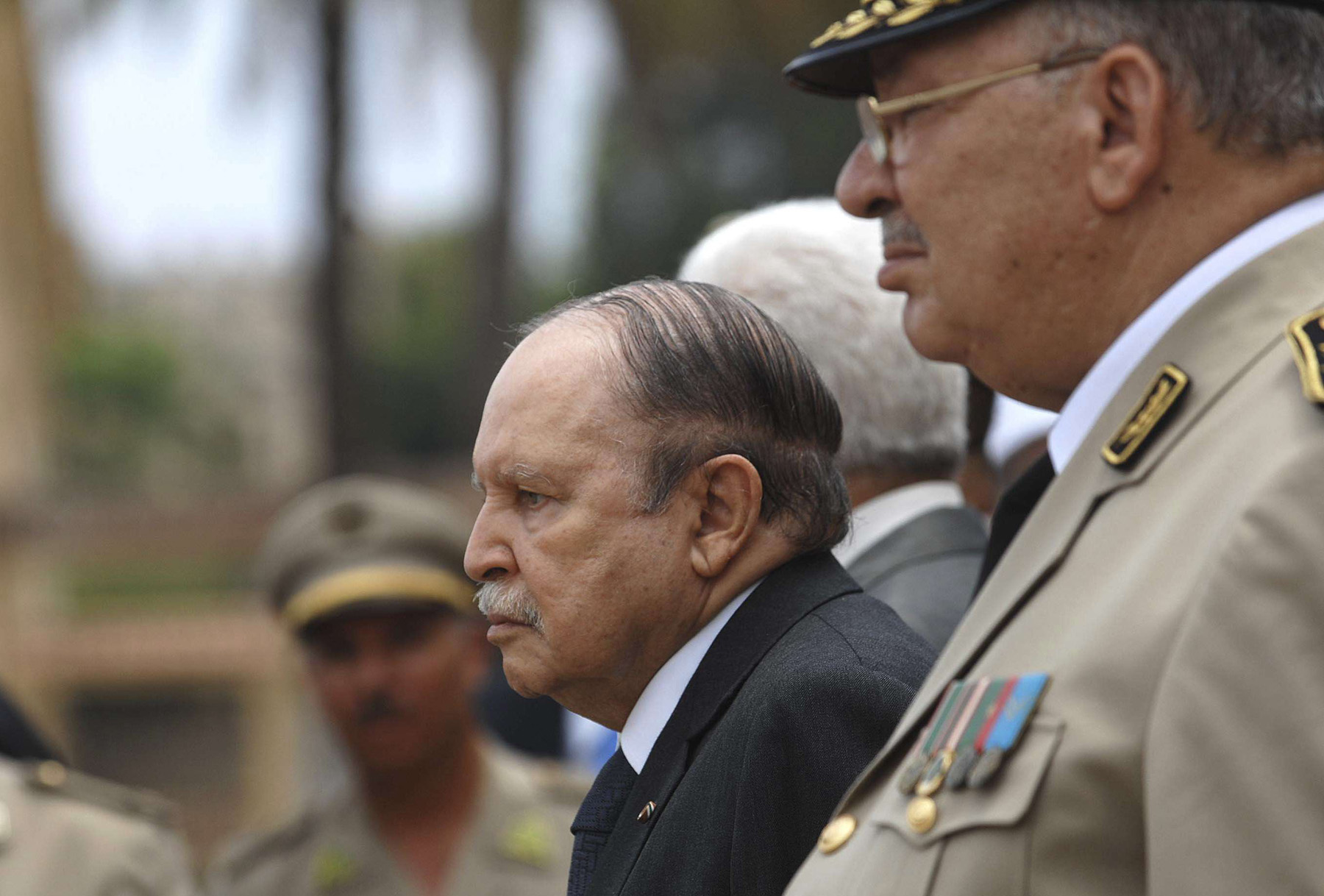 Closing a chapter. A 2012 file picture shows Algerian President Abdelaziz Bouteflika (L) and Army Chief of Staff General Ahmed Gaid Salah reviewing an honour guard near Algiers. (AP)