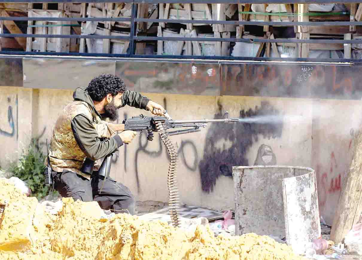 Lawlessness. A militiaman loyal to the Tripoli government fires a machine gun during clashes with Libyan National Army forces south of Tripoli's suburb of Ain Zara. (AFP)