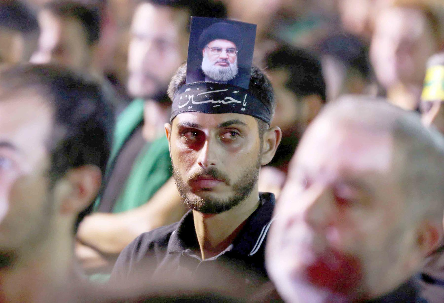 A Hezbollah supporter attends a rally in Beirut. (Reuters)