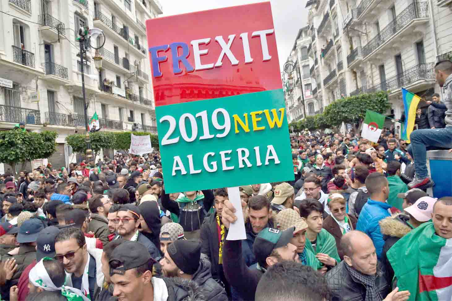 Structural distrust. Algerians take part in a demonstration in Algiers against French involvement in the country's crisis, March 22. (AFP)