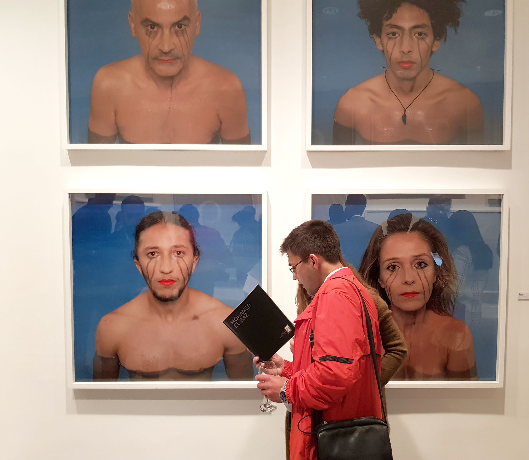 A peculiar dimension. Visitors go through a booklet at the solo exhibition of Moroccan contemporary artist Mohamed  El Baz in Casablanca.  (Saad Guerraoui)