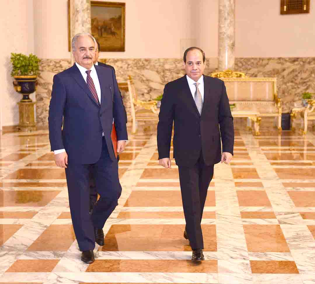 Common concerns. Libyan National Army Field-Marshal Khalifa Haftar (L) walks with Egyptian President Abdel Fattah al-Sisi at the Presidential Palace in Cairo, April 14. (Reuters)